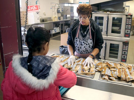 View Ridge Elementary Arts Academy, food server Sheretta Williams readies cinnamon Mini Cinnis for breakfast in the school gymnasium on Friday. This fall, Bremerton schools will no longer offer free breakfast to all elementary students, only to low-income kids.