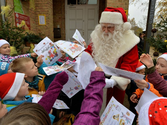 A Santa Claus attends the opening of the Santa Claus