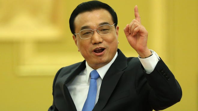 Chinese Premier Li Keqiang spoke to journalists at an annual press conference following the closing of the third session of the 12th National People's Congress at the Great Hall of the People in Beijing, China, on March 15.