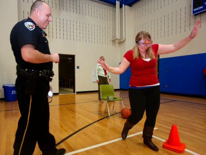 """Charlestown High School's Alexis Anderson underwent a DUI test while wearing the Fatal Vision goggles.  Assistant Chief Jason Broady     administered the tests to students so they could understand the dangers of driving while impaired.  Anderson says """"I could not imagine driving like that, you would wreck and die.""""  Dec. 20, 2013"""