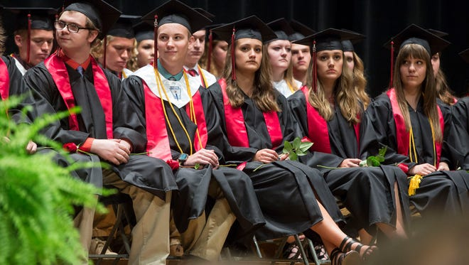 Students walk across the stage for their diplomas as part of their graduation ceremony for Wapahani High School's class of 2018 on June 1 inside Emen's Audtiroium. The graduates from Wapahani High School marked the 50th graduating class from the school.