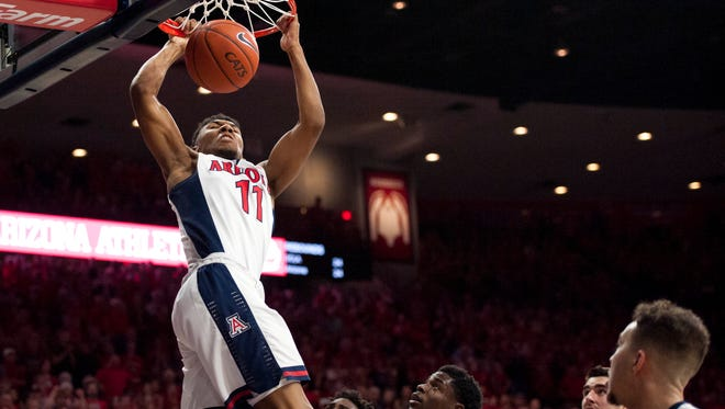 Feb 12, 2016: Arizona Wildcats guard Allonzo Trier (11) dunks the ball during the second half against the UCLA Bruins at McKale Center. Arizona won 81-75.