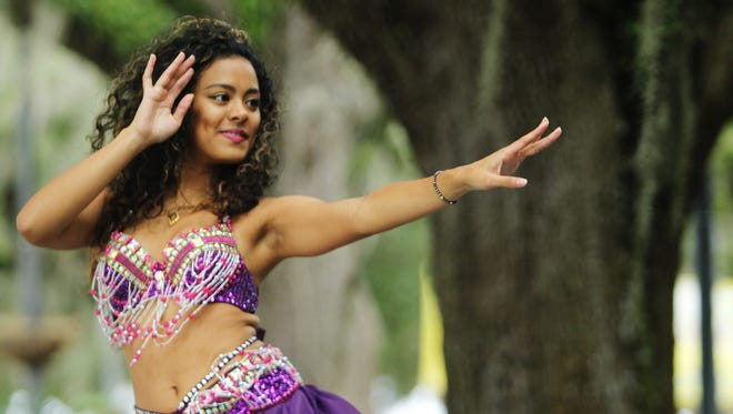 Sarah al Moshaikah, a Florida State University student, performs a belly dance at the Experience Asia festival in 2015.