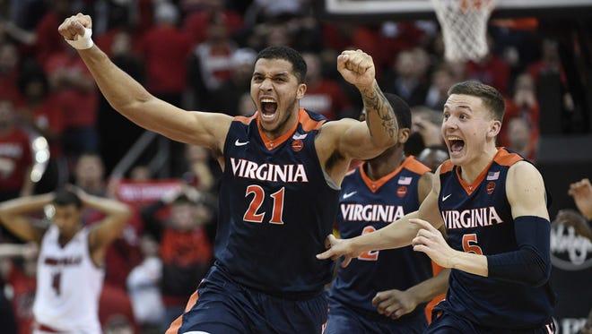 Virginia Cavaliers forward Isaiah Wilkins and guard Kyle Guy.