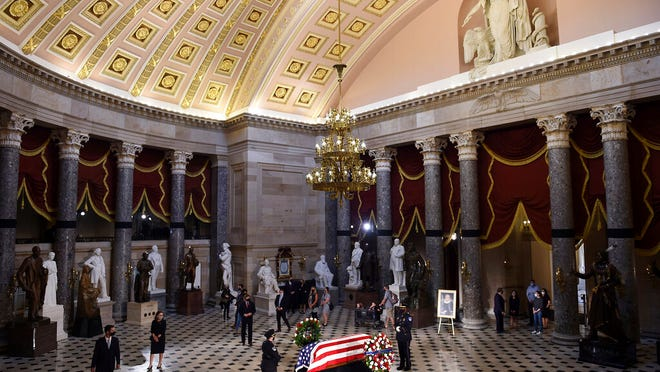 Mourners surround the casket of the late Associate Justice Ruth Bader Ginsburg in the Statuary Hall, where she lie in state at the US Capitol, September 25, 2020 in Washington, DC.