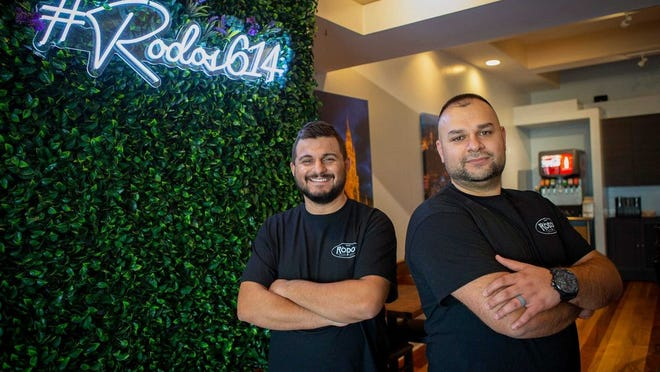 Co-owners and cousins Klaudio Pali, left, and Erion Permeti have opened Rodos European Grill in Clintonville.