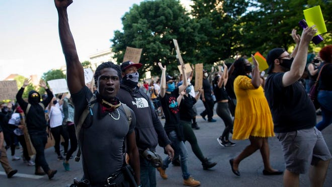 Protesters march down Broad Street on behalf of George Floyd during a protest in downtown Columbus on May 31.