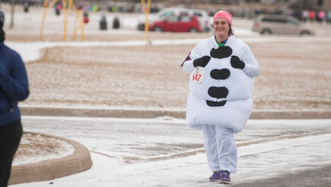 Maryanne Ried, of Ann Arbor, wears a snowman outfit during the 2017 PoHo Hot Cocoa Run in Port Huron. The run starts at 10 a.m. Saturday.