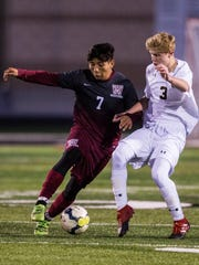 Westside sophomore Pedro Sanchez and T.L. Hanna freshman Colton Kinard fight for possession of the ball at the Hanna vs. Westside high school soccer game on Tuesday, March 14, 2017 in Anderson.