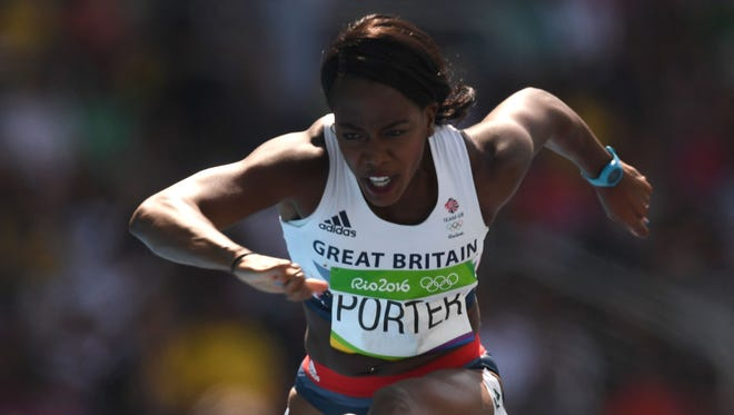 Britain's Tiffany Porter competes in the Women's 100m Hurdles Round 1 during the athletics event at the Rio 2016 Olympic Games at the Olympic Stadium in Rio de Janeiro on August 16, 2016.