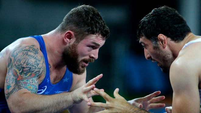 Ben Provisor (left) of the United States and Rustam Assakalov of Uzbekiston compete in the Men's Greco-Roman 85kg 1/8 final match of the Rio 2016 Olympic Games.