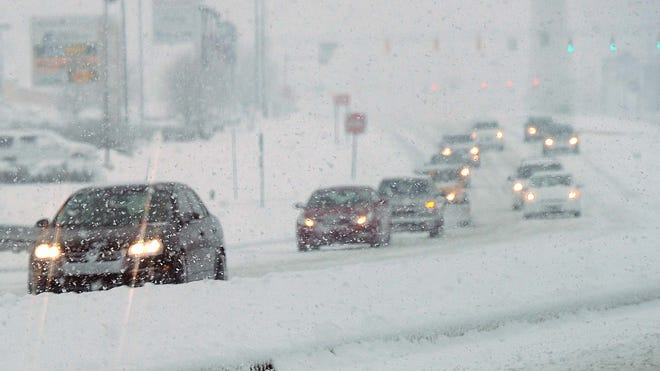 Traffic is seen battling the elements as the snow makes roads slippery.