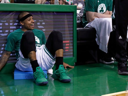 Boston Celtics guard Isaiah Thomas smiles as he watches from the bench late in the fourth quarter of Game 5 against the Washington Wizards in an NBA basketball second-round playoff series in Boston, Wednesday, May 10, 2017. Thomas scored 18 as the Celtics defeated the Wizards 123-101. (AP Photo/Charles Krupa)