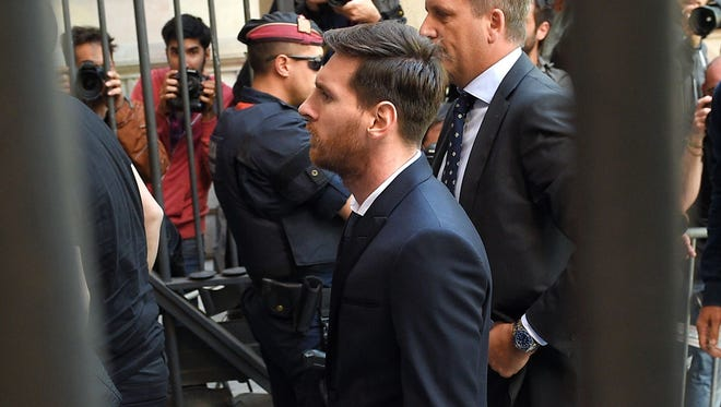 In this June photo, Messi arrives at a Barcelona courthouse.