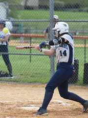 Pine Plains' Cat Simmons hits a two-run homer against Marlboro during a May 2016 game.