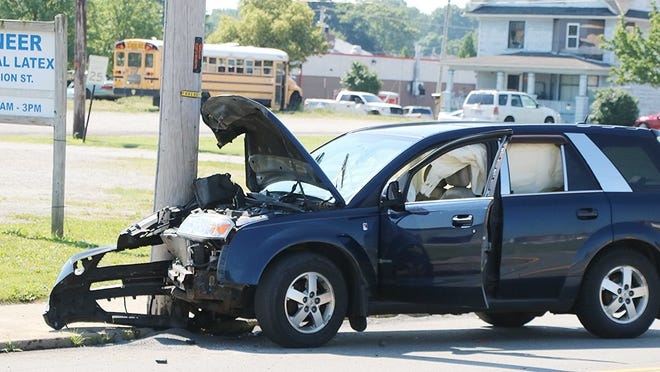 Ashland Fire Department and EMS and Ashland Police Department respond to a single-vehicle crash in the 900 block of Union Street in Ashland on Monday morning. Ashland EMS transported a mother and child to University Hospitals Samaritan Medical Center with unknown Injuries.