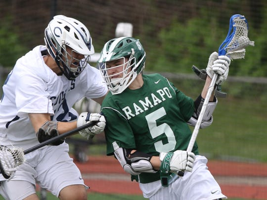 Andrew Robbins (5) of Ramapo battling in the offensive