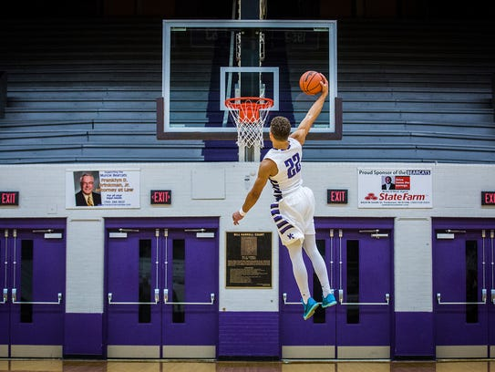 Andre Jones dunks at the Muncie Fieldhouse Thursday,