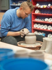 Max Brooks of Collingswood creates a piece of pottery at Say It With Clay studio in Collingswood.  Say It With Clay is a non-profit organization that helps people with diverse special needs benefit from the therapeutic power of clay. Revealed through a level of relaxation, this process creates pride, success and motivation for healing. Say It With Clay utilizes a hands-on therapeutic approach using clay to offer clients effective alternative channels for communication.  01.27.16