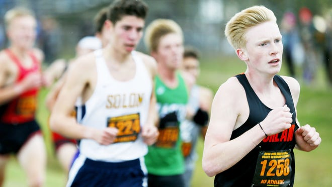 Ashland High's Dylan Hickey (right) competes in the OHSAA Cross Country State Tournament on Nov. 2, 2019 at National Trail Raceway in Hebron.