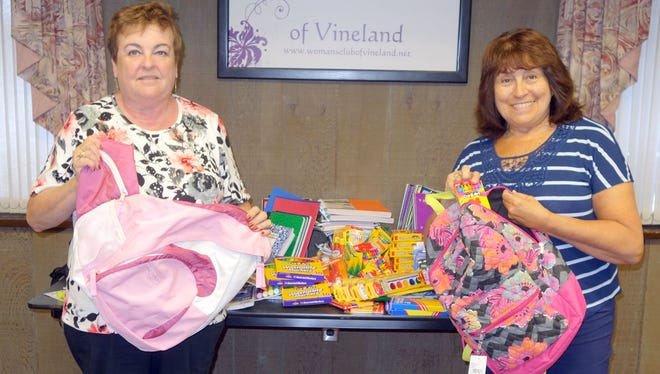 Norene Ritter (left), president of the Woman's Club of Vineland, and Linda Galena, the club's education committee chairperson, gather school supplies for the Boys & Girls Club of Vineland.