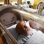 Since the hyperbaric chamber at the Wound Care Center is pressurized and soundproof, internal speakers provided sound for a television, and a phone is used to talk to patients.