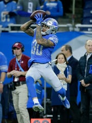 Detroit Lions cornerback Teez Tabor (30) catches during