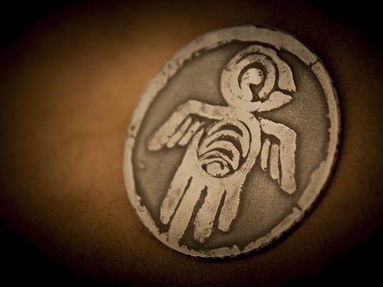The Seeker Coin from the film 'Legends From the Sky' is pictured.