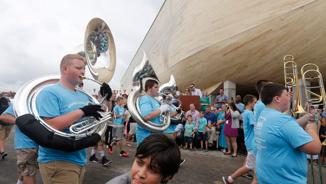 A young boy attempted get out of the way of a marching band during festivities at the Ark Encounter, in Grant Co., Ky. July 5, 2016.