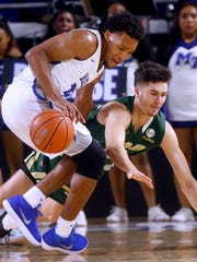 MTSUÕs David Simmons (21) steals the ball away as UAB's Nate Darling (13) falls to the floor  on Saturday, Feb. 24, 2018, at MTSU.