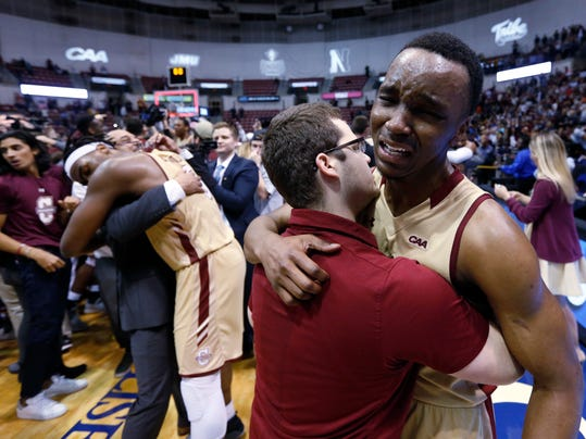 College of Charleston's Joe Chealey, at right, shows his emotions after defeating Northeastern in overtime 83-76 of an NCAA college championship basketball game in the Colonial Athletic Association tournament at the North Charleston Coliseum in North Charleston, S.C., Tuesday, March 6, 2018. (AP Photo/Mic Smith)