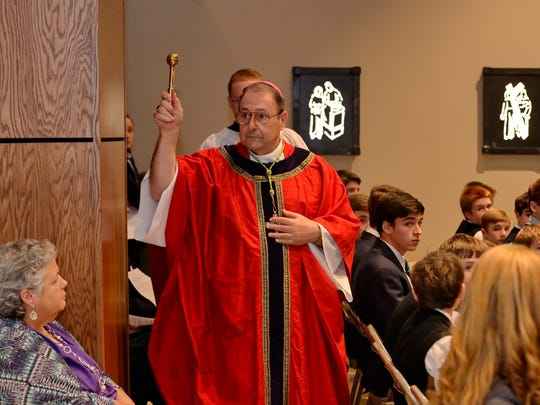 Most Reverend Robert Guglielmone, Bishop of Charleston, blesses the new chapel at St. Joseph's Catholic School