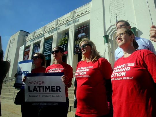 Members of the Westchester Chapter of an organization called Moms Demand Action for Gun Sense in America, listen as State Senator George Latimer, who is running against Rob Astorino for Westchester County Executive, renewed his call for an end to gun shows at the Westchester County Center Oct. 3, 2017.