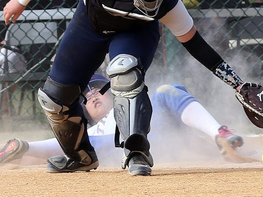 North Salem's Natalie Intrieri (1) slides safe into home on teammate Maggie Boardman's two-run single in the 7th inning as Pine Plains catcher Catherine Simmons takes the late throw in the Class C state regional semifinal at Rhinebeck High School June 2, 2016. North Salem won the game 7-6.