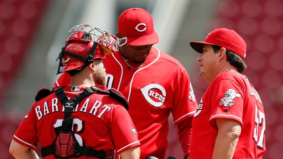 Reds pitching coach Mack Jenkins (right) talks with