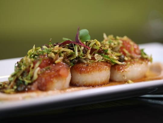 Pan seared scallops with brown butter, grapefruit,