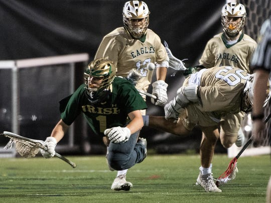 York Catholic goalie Jarred Kohl (1) and Bishop Shanahan's Michael Tagliaferri get tripped up while going of the ball, Tuesday, June 5, 2018. Bishop Shanahan beat York Catholic, 17-5, to advance to the PIAA finals. Tuesday, June 5, 2018. Bishop Shanahan beat York Catholic, 17-5, to advance to the PIAA finals.
