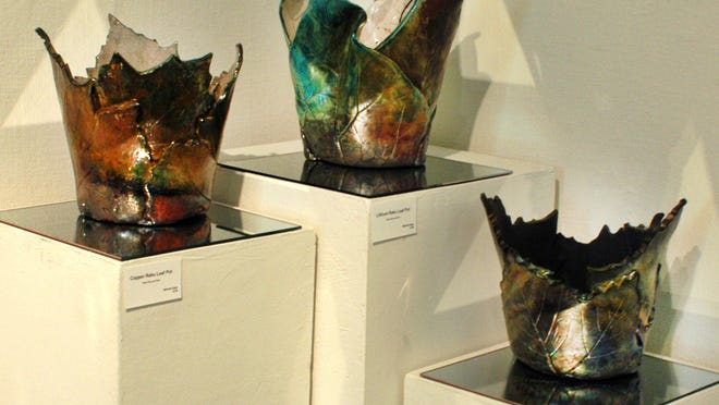 The veins of the leaves add another dimension of surface character to Belinda Kiger's Copper Raku Leaf Pots.