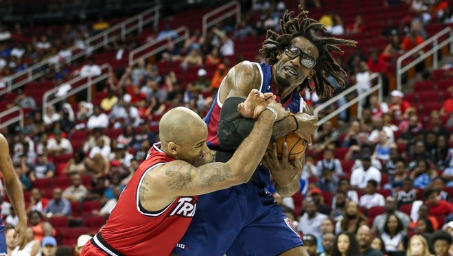 Trilogy Dahntay Jones (1) attempts to strip the ball from Tri State Amar'e Stoudemire (1) during a BIG3 game at Toyota Center in June.