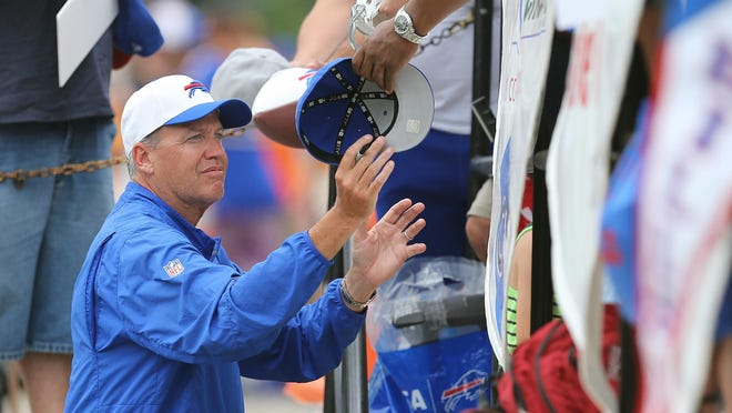 Bills head coach Rex Ryan finds time to sign autographs for fans before a night practice at St. John Fisher College.