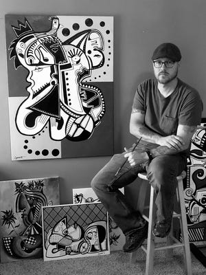 Jason Chambers works in mostly monochrome and his art often contains bold hard-edged shapes that bring to mind mysterious symbols or ancient hieroglyphics that the viewer must decode.