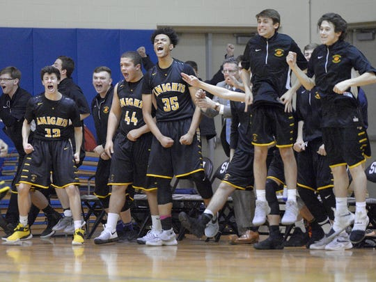 The McQuaid bench reacts to a 3-point basket late in the game during a regular-season game Wednesday, Feb. 1, 2017, against Monroe. McQuaid won in overtime 78-75.