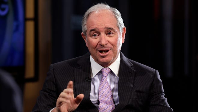 """File photo taken in 2014 shows Blackstone Group CEO Stephen Schwarzman being  interviewed during the Fox Business Network's   """"Opening Bell with Maria Bartiromo"""" program."""