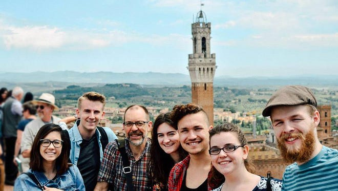 Evangel University students studied art in Italy this spring. From left, Danielle Huver, Colin Turnbull, Prof. Michael Buesking, Katelyn Hammons, Nathan Bussard, Athena Lester and Zane Burgess in Siena, Italy, from the outlook of the cathedral museum.