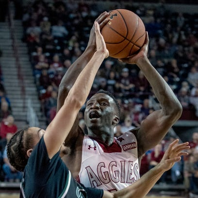 Sidy N'Dir and the New Mexico State Aggies host Missouri-Kansas