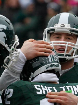 Michigan State quarterback Connor Cook, right, and receiver R.J. Shelton (12) celebrate Shelton's touchdown reception against Rutgers during the second quarter of MSU's 45-3 win Saturday in East Lansing.
