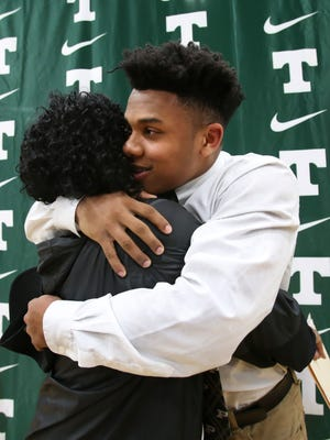 Trinity High School senior Rondale Moore, 17, right, hugs his mother Quincy Ricketts after signing to play football for Purdue University during National Signing Day at Trinity High School. Feb. 7, 2018