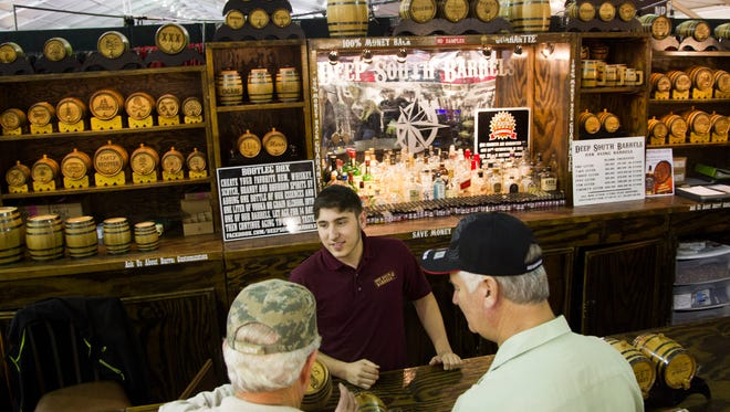 Deep South Barrels' Jeffrey Ruth sells barrels and ingredients to make your own whisky during Barrett-Jackson at WestWorld of Scottsdale on Sunday, Jan. 11, 2015.