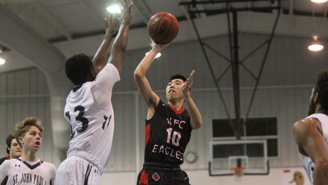 NFC's Chris Pham shoots a runner over a defender during a District 1-3A semifinal.