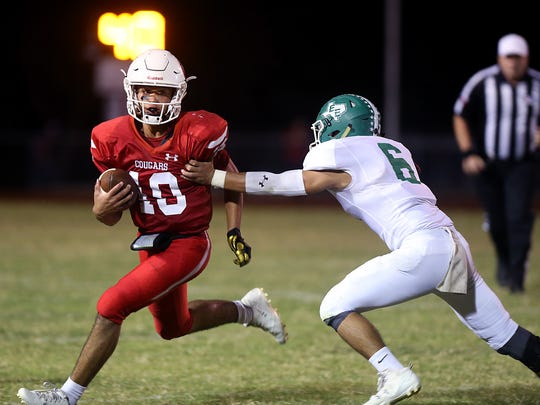 Christoval Cougar Brayden Wilcox escapes a tackle during